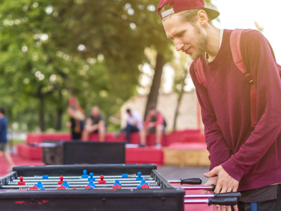 Playing Foosball outside for social distancing while playing games.