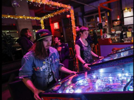 Playing Stern Pinball games.