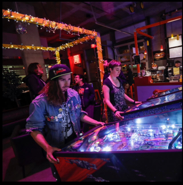 Playing Stern Pinball games.